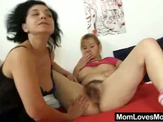 Two ladies tantalise strap on plastic cock