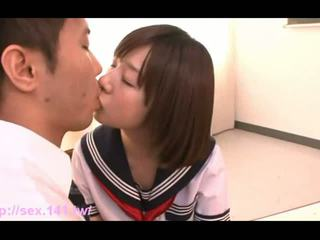 Sweet Japanese schoolgirl suckles on a...