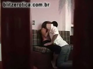 Spycam fucking hot neighbor with gym clothes on couch