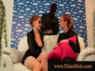 Glamorous lesbians toying with fake cock and bukkake slime