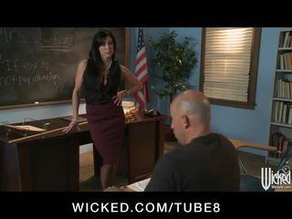 Strict brunette teacher punishes her student in class
