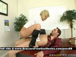 Mature busty naked blonde slut at work on the table