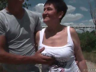Busty grandma fucking her young boyfriend outdoor