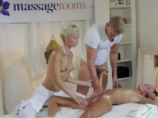 Hot Brunette In Threesome With Masseurs Couple