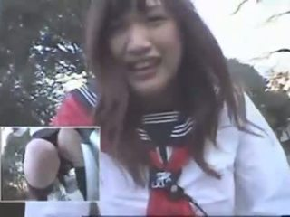 Japanese Girl riding a Vibrating Bicycle thru the City (Public Squirting)