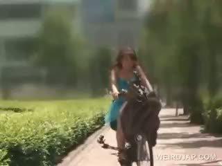 Teen Asian Redhead Riding The Bike Gets Teased Upskirt
