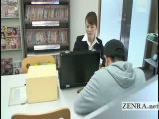 japanese sextoy saleswoman gives under...