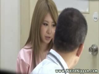 Hottest asian getting her tits out for this doctor