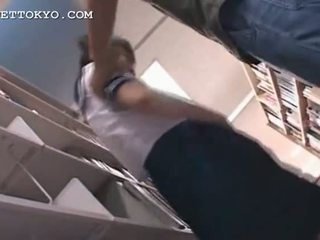 Asian schoolgirl pussy teased in the library on