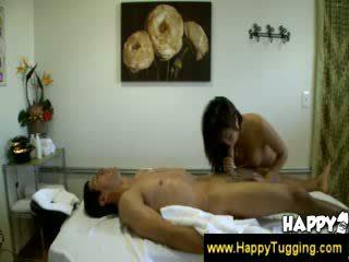 Thai girl strokes shaft with oily hands