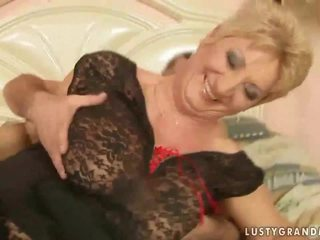 Grandma in fishnet stockings enjoys hot sex
