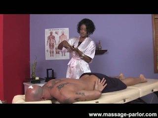 Big tits ebony masseuse gives super hot handjob