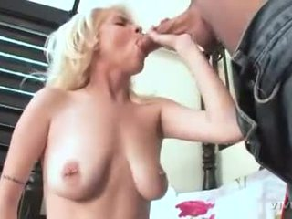Saggy tit slut Kissy Kapri stuffs filthy mouth with enormous dick sucking deep