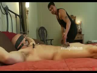 Blindfolded and gagged homo guy is tied to a bed and has his nipples clamped by his oriental Master