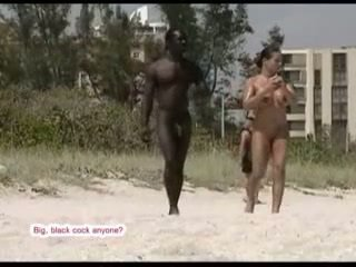 Interracial couple nude on the beach