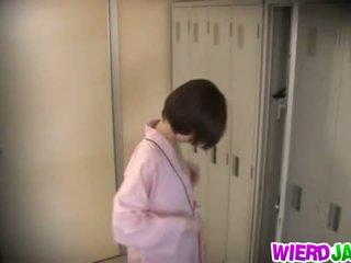 Wierd japan: cute asia babes getting their boobs examined.