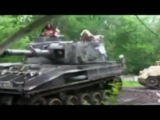 Nua hotties driving um tank!