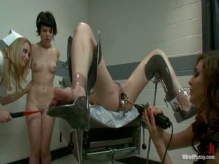 Two kirli pussys have strapped to a gyno chair and bumped by their lesbie doctors