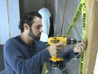 Construction robotník takes a prestávka na beat preč