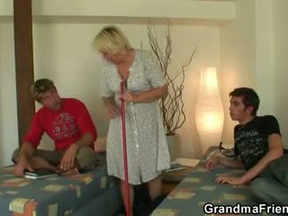 Blonde granny swallows two cocks