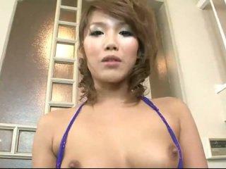Japansk babe milking en liten pikk