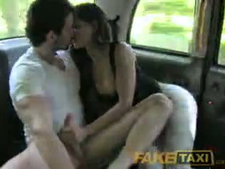 FakeTaxi Spanish couple have hot sex in back of taxi