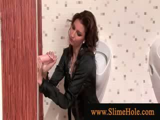 Glamorous slet showered in glory hole slime