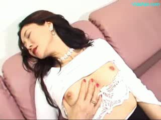 Mature Woman Masturbating On The Couch Using vibrator