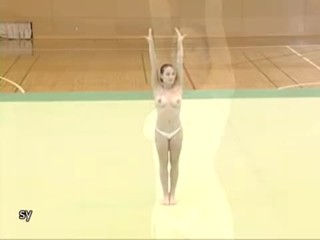 Corina doing topless gymnastics