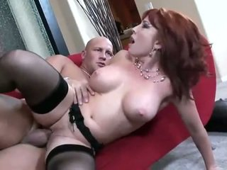 Big boobed redhead fucked in stockings