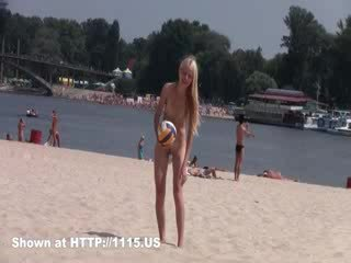 Two skinny nudist babes frolic around the beach