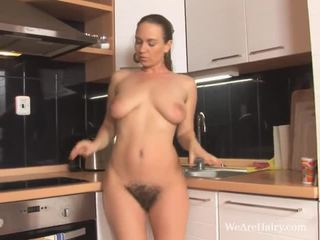 Erin Eden fingers her hairy pussy