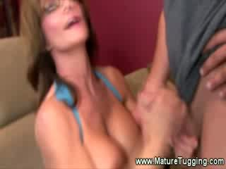 Sweet sexy MILF is giving a handjob