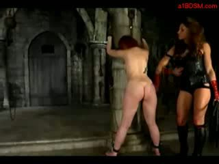 Redhead Girl Tied To Pillar Spanked Whipped Licking Mistress Boots In The Dungeon