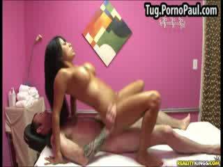 Fake titty Asian babe riding cock