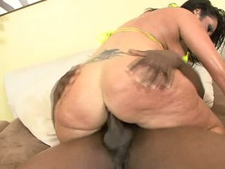 Slutty white milf handles with really huge Ebony dick.