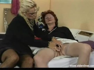 Old lesbians in business suits get it on