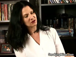 Dark Haired Honey Smoking And Undressing Inside The Library