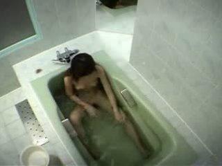 Japanese girl rubs her clit in bathtub