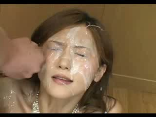 Two guys jizz on Japenese chick face