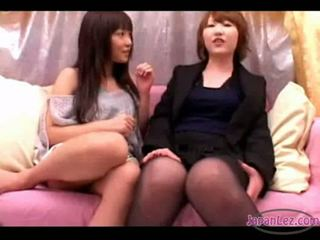 2 asian girls kissing sucking tongues spitting on the couch