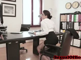 Busty office spex babe gets cumshot on tits