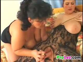 Chubby Amateur Lesbians On A Bed With Toys