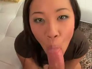 Playful thai girl in sneakers does hot blowjob to tattooed hunk
