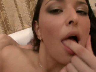 Cute brunette slut slurps on raging hard boner