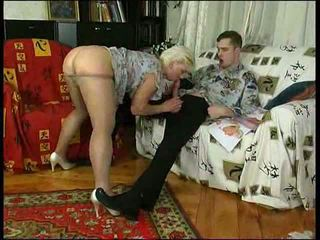 Horny mom in stockings teaches lad