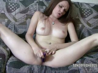 Horny redhead Raine uses her toy to make herself cum