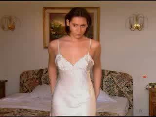 Brunette in white satin nightie masturbates