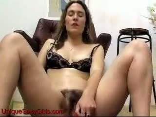 Bizarre hairy amateur toying her pussy and pissing
