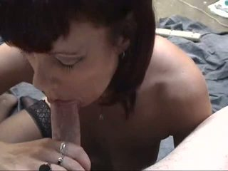 Mature brunette with floppy tits spreads her shaved pussy for dude's fingers